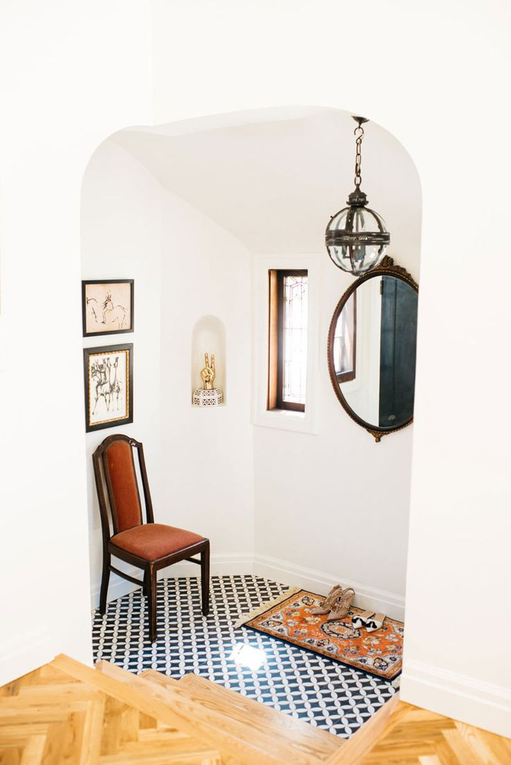 A tiled entryway blends Old-World charm anda modern appreciation for cheeky accents.