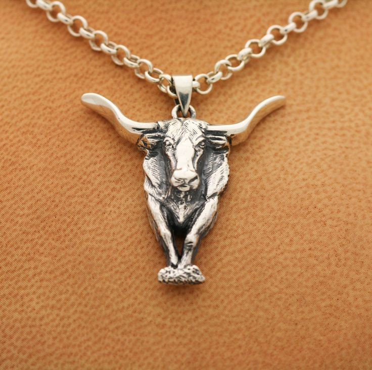 The #TexasLonghorn #Bull is an icon of #Texas.  #Elite #Longhorns have sold for up to $170,000. It was first brought over by #ChristopherColumbus. Its #horns extend up to 7 feet long. It's the only breed immune from Texas fever, a deadly cattle disease. From its #strength and #resilience, it conquered nature's #survivalofthefittest. The #longhorn is superior.  Show your strength, resilience and superiority with the Silver Texas Longhorn Bull #Pendant available at http://mava.co/1cCjPGB .