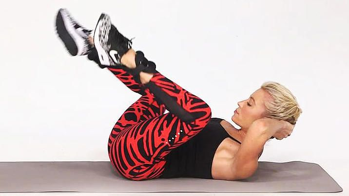 In this video, celebrity fitness trainer Tracy Anderson shows you how to do a Knee Pull Crunch. While basic crunches target just your abs, this move works your legs as well as your lower belly.