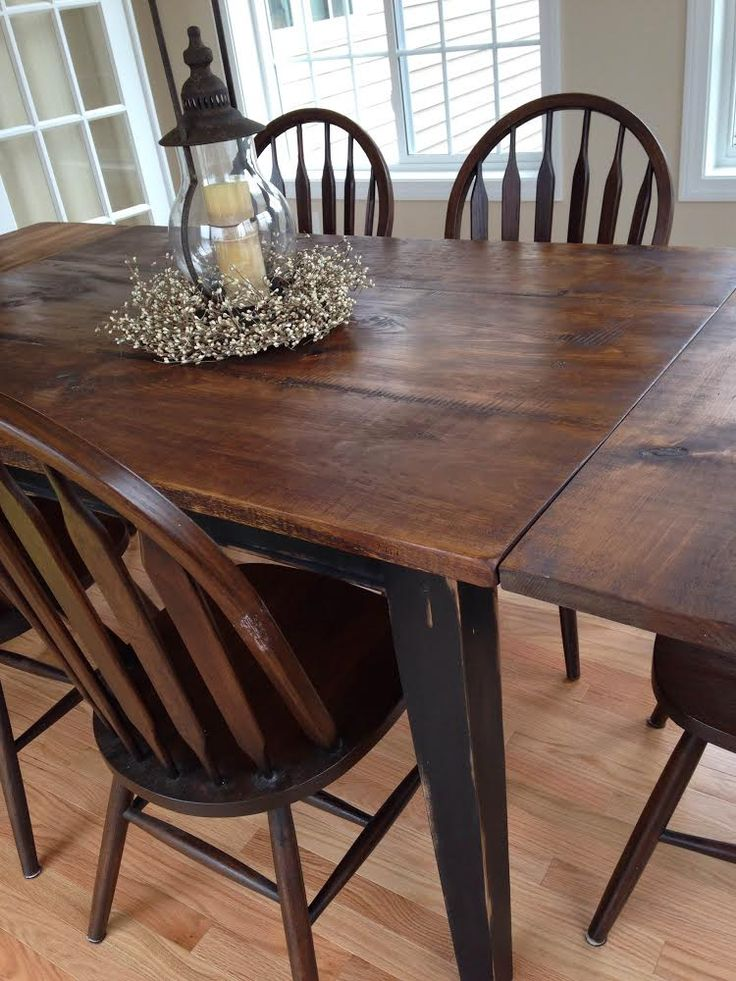 Farm table with end leaf. Base is painted black and