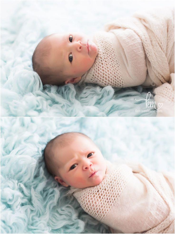 awake newborn baby wrapped up - awake newborn photography pose