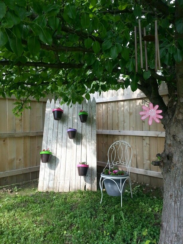 Hanging flower pots and flower chair