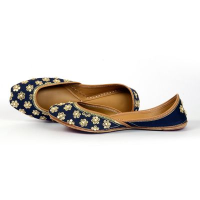 Designer Juttis from NeedleDust India. You are going to love us! Our juttis are made in genuine leatherand are easily twisted in hand, making the jutti extremely soft on your feet. All our probucts are hand embroidered and hand sewed. Known as Aladdin slippers, Indian Ballerinas etc., the Indian Punjabi traditional footwear. The jutti is spotted everywhere, complementing jumpsuits, maxis, short dresses and jeans.