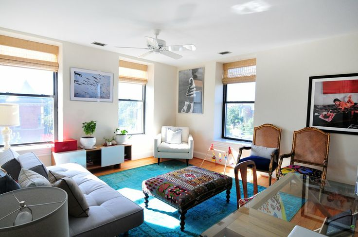 Another nice example of a colorful living room with white walls.