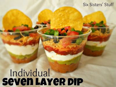 Individual Seven Layer Dips- perfect for a BBQ or potluck dinner. And they are just so cute! :) SixSistersStuff.com #appetizer