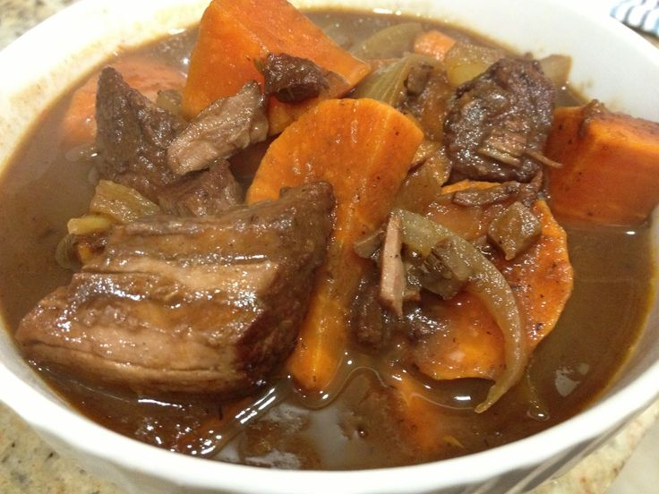 Sweet potato pot roast with carrots, onions and thyme. Slow cooked a ...