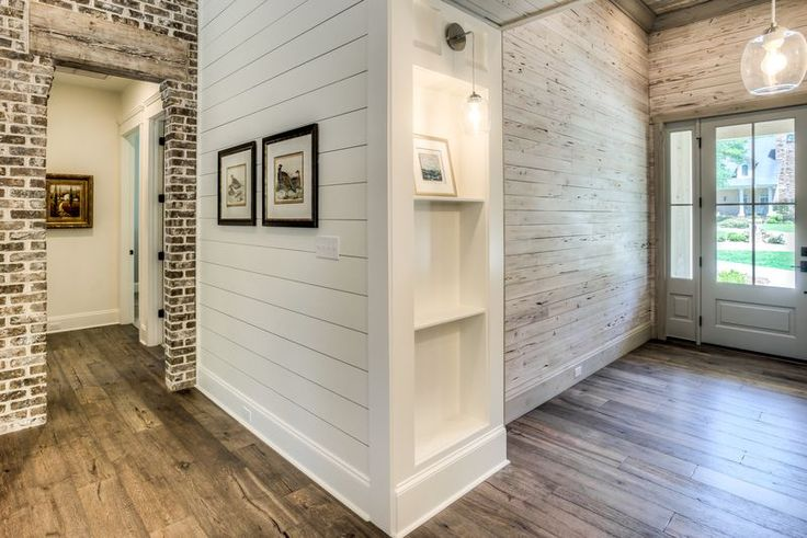Love the brick wall with wood beam above door opening. Shiplap walls!