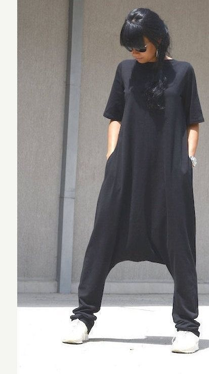 woman black jumpsuit, Black Jumpsuit, black harem jumpsuit, linen jumpsuit, ladies jumpsuit, jumpsuits for lady, Loose Jumpsuit, drop crotch  You will be right on trend with your Plus size jumpsuit for women. A one piece black jumpsuit with two pockets offering a comfortable loose fit. Harem pants available starting with XSM thought 3XL and plus sizes too.  Materials Cotton, Viscose, Lycra  Care instructions Machine Wash Cold / Hand Wash Cold Dry cleaning Hang up to Dry  Use following ti...