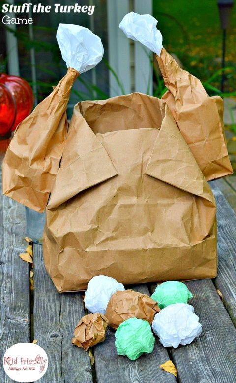 """Stuff The Turkey: With a few twists, a large paper bag becomes a turkey — perfect for throwing balls of """"stuffing"""" into! Click through for more Thanksgiving games for your little ones to play."""
