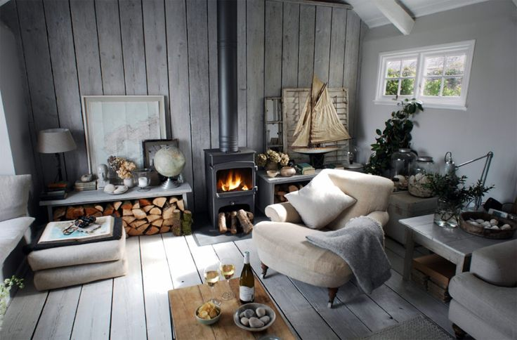 I like the firewood storage that provides seating or display area. Love the whole room of this small home. the-oyster-catcher-2