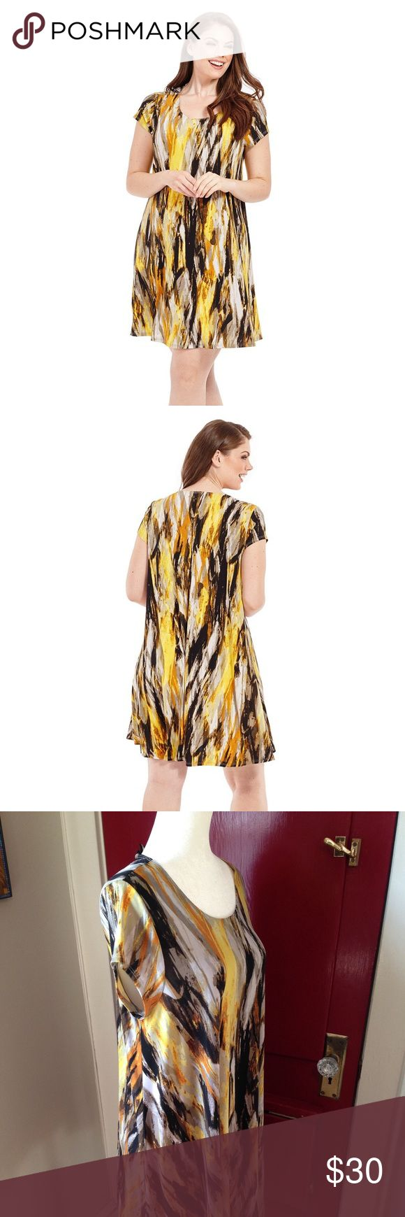 KAREN KANE Brushed Yellow Trapeze Dress KAREN KANE  trapeze dress with flattering silhouette.   Beautiful print  Stretch-jersey fabric  Slip on design Karen Kane Dresses
