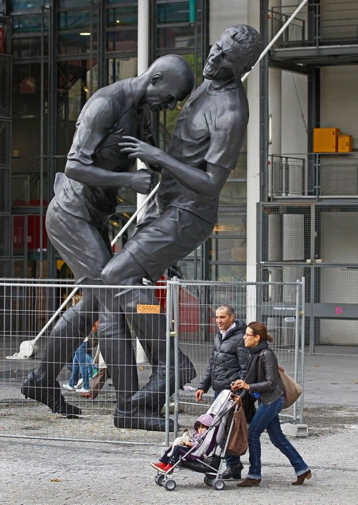 A sixteen foot-high bronze statue portraying french soccer player Zinedine Zidane's head-butting incident against Italian Marco Materazzi in the 2006 world cup final has been erected in front of the centre pompidou in paris. Created by Algerian artist Adel Abdessemed, the larger version of abdessemd's earlier 'coup de tête' depicts the incident t