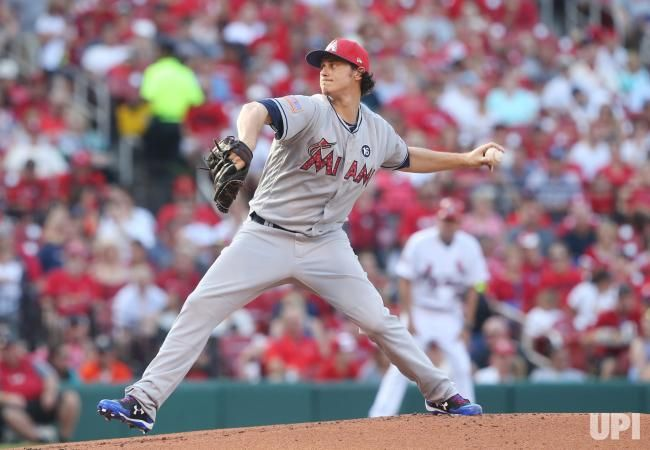 Miami Marlins starting pitcher Jeff Locke delivers a pitch to the St. Louis Cardinals in the first inning at Busch Stadum in St. Louis on…