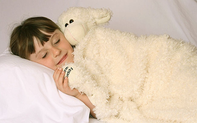 Warm Buddy - Wooly the Sheep Baby Blanket    Wrap your baby in total warmth and comfort with Warm Buddy ultra cozy and cute Wooly baby blanket. One side of the blanket has a Wooly plush sheep for a good friend with a tail on the other side and 4 legs at each corner. Really cute and super soft.  This product is not to be heated!