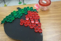 bottle cap collage fruit... hmmmm... lots of directions to go w/ this.