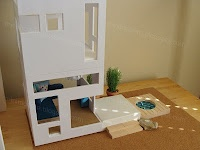Mini Modern made a two-story house out of Teddy Luong's Fish Condo Tanks as room boxes.    The Goods: Furniture is Hape, Plan Toys, Lundby and Momoll; All accessories are Lundby, Mini Modernistas, Fisher Price, AG Minis, Breyer, Re-Ment, CB2 and Silver Acorn.    Found at http://smallforbig.com/2010/08/midcentury_modern_eames_kids_finds.html.