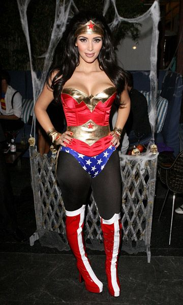 Kim Kardashian showed off her assets in a curve-hugging Wonder Woman costume at her 2009 soiree.