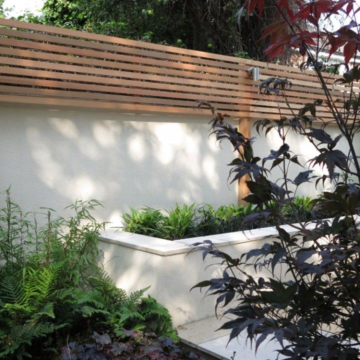 fence on top of rendered wall