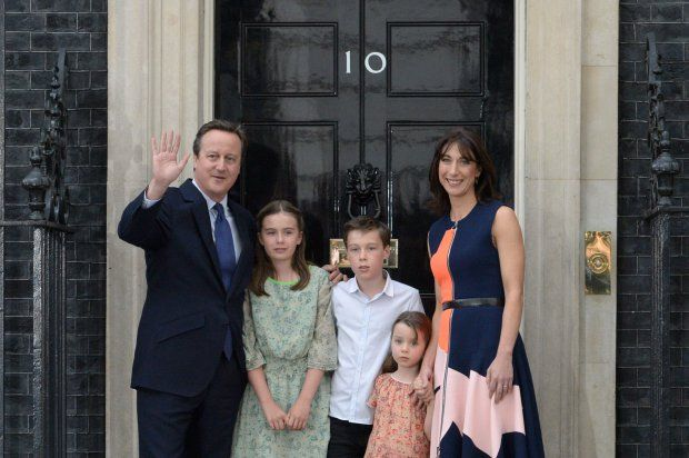 Outgoing British prime minister David Cameron (L) waves outside 10 Downing Street with his family (L-R) his daughter Nancy Gwen, son Arthur Elwen, daughter Florence Rose Endellion and his wife Samantha Cameron in central London on July 13, 2016 before going to Buckingham Palace to tender his resignation to Queen Elizabeth II. Outgoing British prime minister David Cameron urged his successor Theresa May on Wednesday to maintain close ties with the EU even while negotiating to leave it, as he…