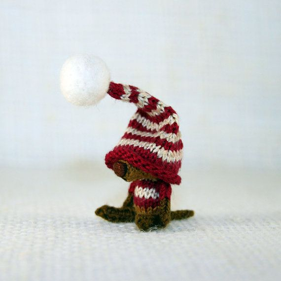 Funny Dog in a striped red and white cap knitted by SecretFriends