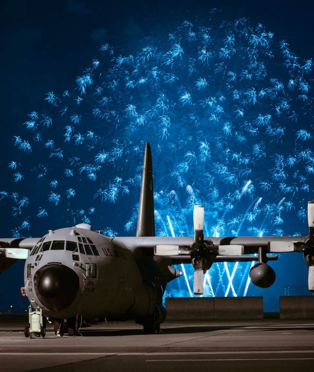 July 13, 2015: Fireworks light up the background of a C-130 Hercules in Japan during Celebrate America, an annual Independence Day celebration for military members and their families.   - PopularMechanics.com