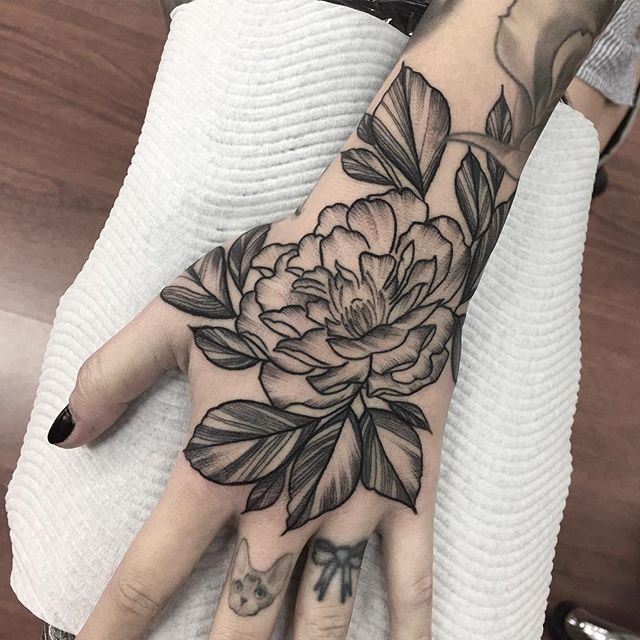 Peony on the hand for my girl @cheri_may below some perfect black and grey by @tattoosbyspot just a little bit intimidated