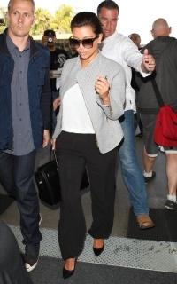 Kim Kardashian in Gianvito Rossi black patent pumps, jacket by Improvd, Hermes black birkin, Kardashian Kollection tank, sunnies by Tom Ford & Kardashian Kollection woven trousers.