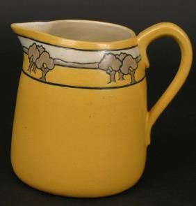 """Circa 1913 signed SEG (Saturday Evening Girls) pottery creamer, yellow ground with landscape band, 5""""h, artist initialed 'FL'."""