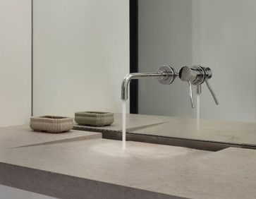 The sink is made from a single slab of stone and installed like an infinity edge shower floor. Modern and perfect! Aquabrass faucet