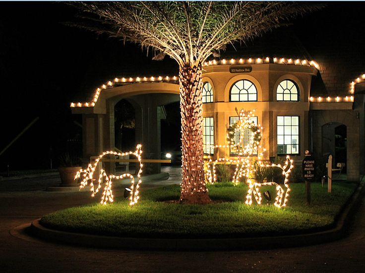 miller lights decorates many hotels town centers restaurants housing developments and resorts for the holidays these deer grazing on the lawn are a - Deer Christmas Lights