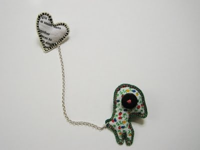 Creature with heart clutch back brooch.  Rescued fabrics and buttons