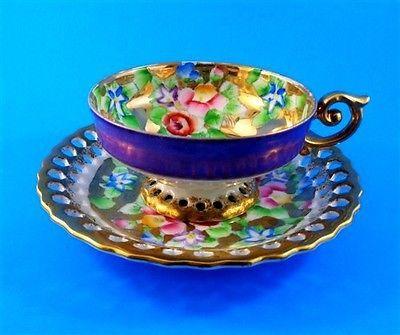 Rare Reticulated Purple and Handpainted Florals on Gold Japan Tea Cup and Saucer