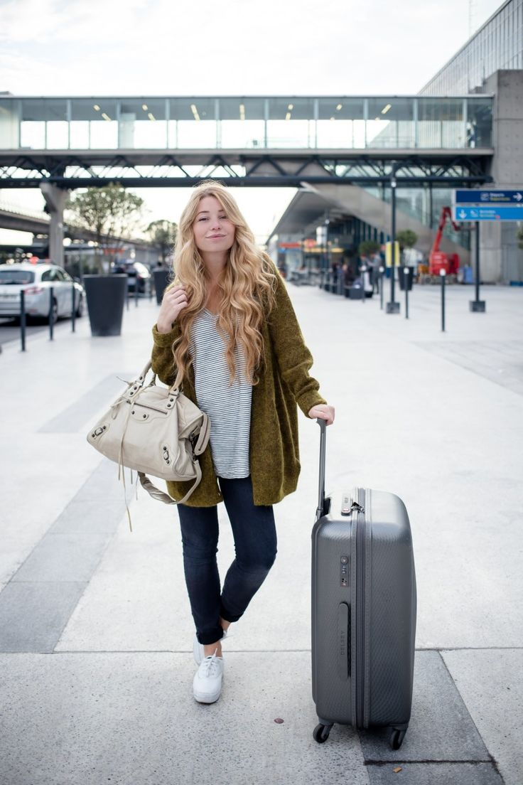 My long flight outfit essentials: an oversized cardigan, Balenciaga bag and Delsey suitcase