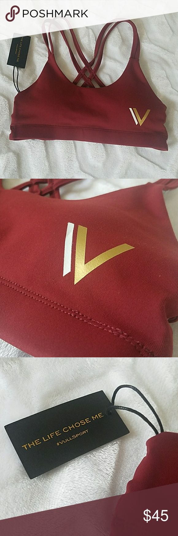 NWT Vull Caged Sports Bra Vull Sport brand. Maroon color with gold/white logo graphic on front side. Strappy and caged back detail! Heathered grey interior with removeable pads. This is NWT, women's size XS Vull Sport Intimates & Sleepwear Bras