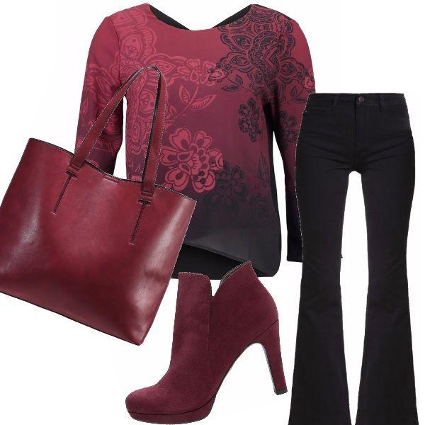 Perfetto per una passeggiata in un pomeriggio di fine estate, indossando una camicia a manica lunga su pantaloni di jeans scuro a campana anni '70, stivaletti e borsa color vinaccia.