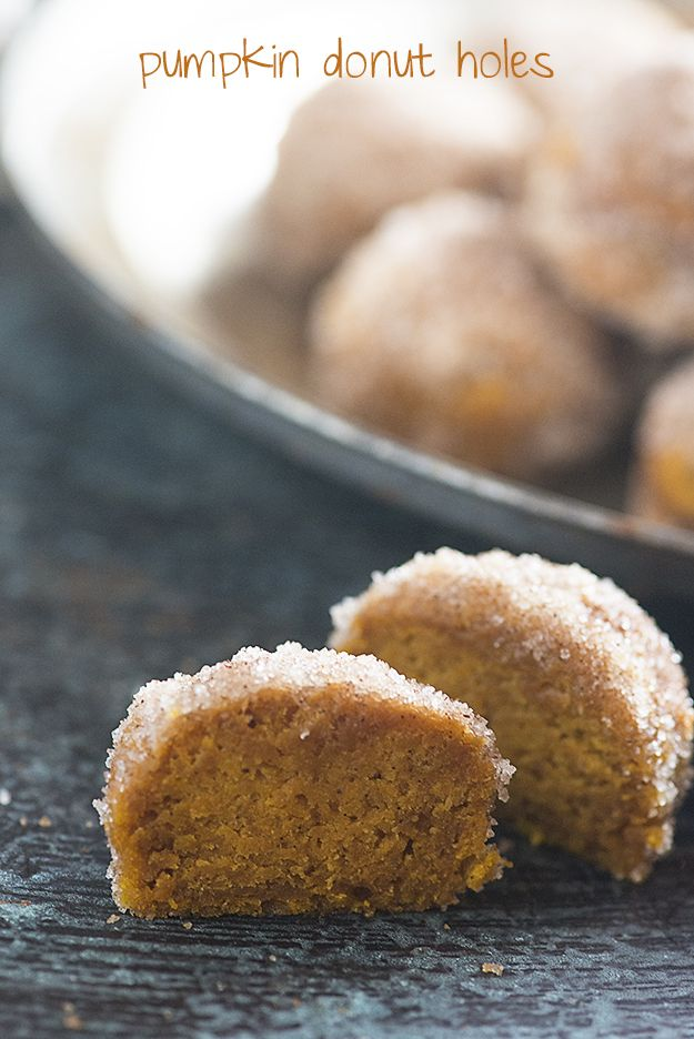 Baked pumpkin donut holes! These are dense like a pumpkin pie, but coated in butter, cinnamon, and sugar so they taste like a fried donut!