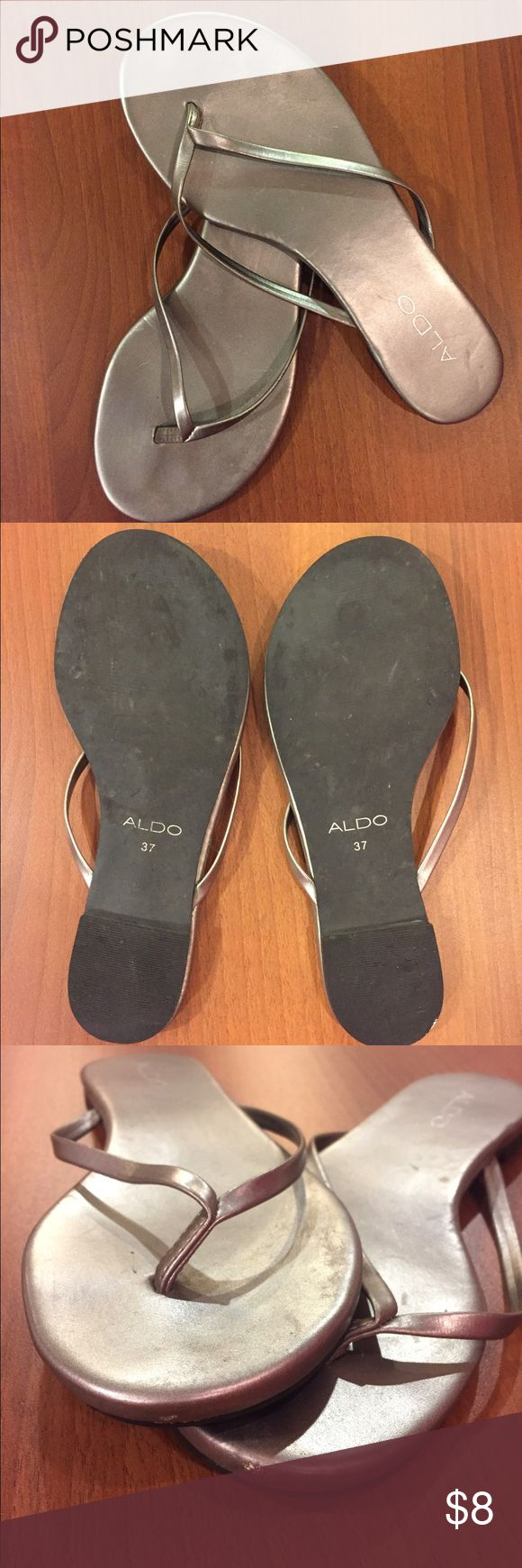 Aldo silver flip flops Aldo silver/grey flip-flops in good condition. Wore a handful of times. Minor scratches shown in photos. Size 7 Aldo Shoes