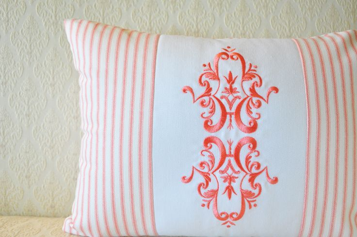 "Celebrate your early American heritage with this elegant, decorative accent pillow named in honor of Betsy Ross, who sewed the first American flag. This coral-and-white pillow has an embroidered inset. OPTIONAL: Frame the pillow with piping (choose ""Add Piping"" in the drop-down menu).  This early 18th-century American embroidery is a Martha Pullen replication from an original embroidered waistcoat at The Daughters of the American Revolution Museum in Washington, D.C. The embroidery came from…"