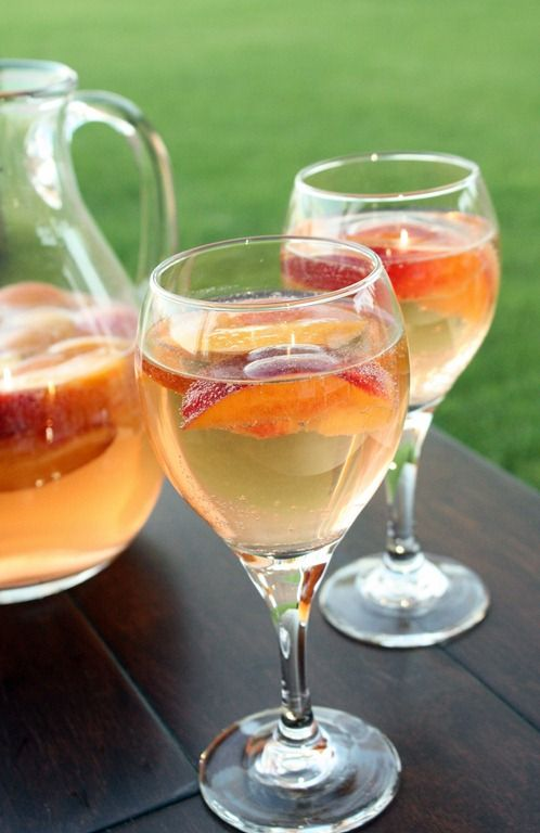 Sparkling White Peach Sangria..Substitute peach vodka with peach schnapps and add halved green grapes ^_^