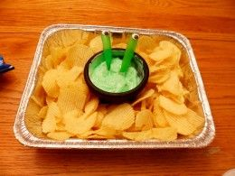 A fun way to serve alien themed chips and dip. Dip has spoons with eyeballs.
