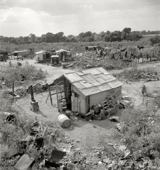 "We need to look at this picture the next time we want to complain about our lives.  August 1936. ""People living in miserable poverty. Elm Grove, Oklahoma County, Oklahoma."" A good (or bad) example of the Depression-era shantytowns known as Hoovervilles. Medium-format negative by Dorothea Lange."