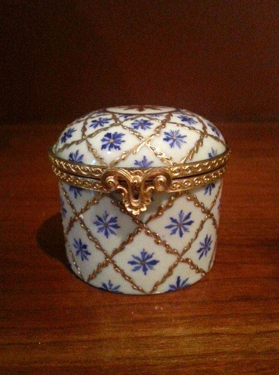A 20th century Le Tallec French Limoges porcelain. Hand gilded with raised gold beads trellis-work ,that surround the enameled blue flower hand painted