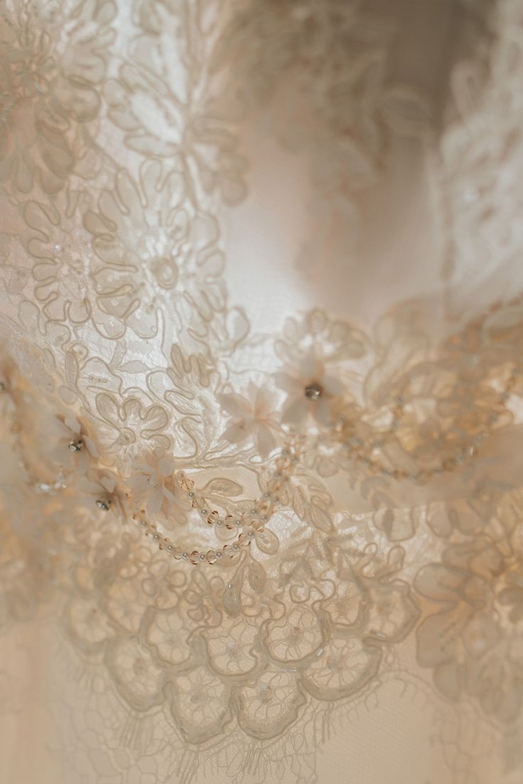 Close up of a separate bodice. Beaded lace with rose pink beading detail