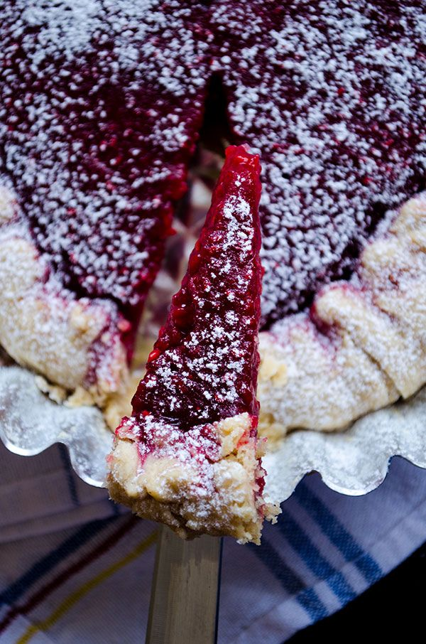 Tangy rustic raspberry tart with crispy edges and moist in the centre | giverecipe.com
