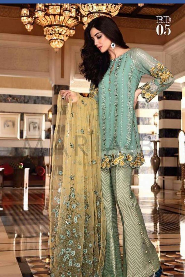Pakistani designer Maria b short shirt with bell bottom trouser.