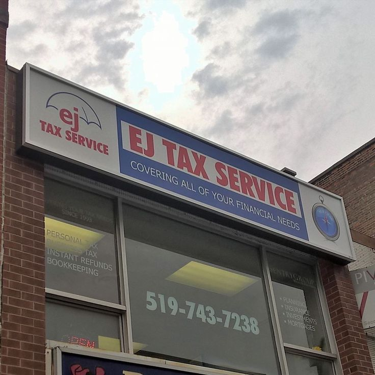 Second storey window graphics and illuminated sign for EJ Tax Services.  #yoursignguys #signs #sign #fascia #windowgraphics #kitchener #kwawesome #makeitkitchener