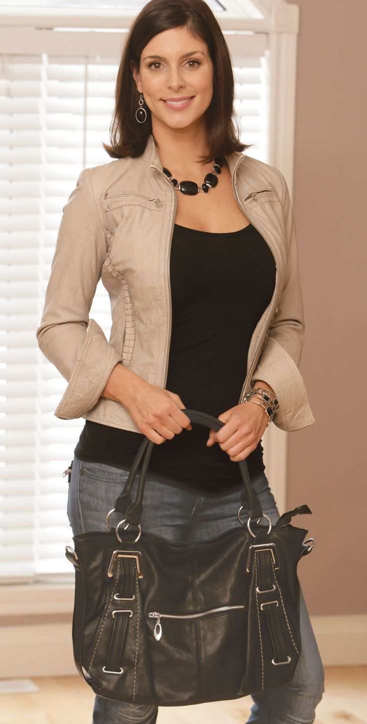 Zoe Handbag - This striking black handbag features silver metal accessories, a removable cross-body shoulder strap, a zippered top closure and two zippered outer pockets, as well as convenient open and zippered inner pockets. Beautifully crafted from subtle faux leather. Find out more at www.EverydayStyle.com
