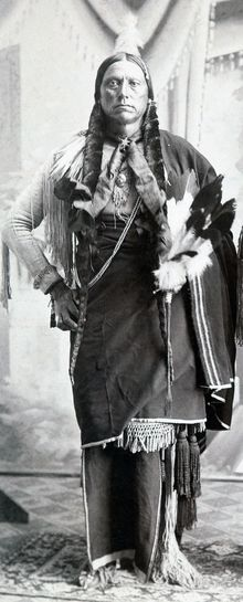 Quanah Parker in ceremonial regalia, c1890.png -Quahada Comanche tribe(1890-1911) - born 1845 or 1852, died Feb 23, 1911 due to heart failure by rheumatism at Quanah Parker Star House, Cache Okla, - Comanche leader to bring Quahada band into Ft Sill - founder of Native American Church & peyote religion - parents: Peta Nacona with Cynthia Parker - spouses: Chony, Mah-Chetta-Wookey-Ah-Uh-Wuth-Takum, Coby, Toe-Pay, & Tonarcy.