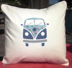 I feel the need to use this idea to make a very colorful VW Bus lap quilt...