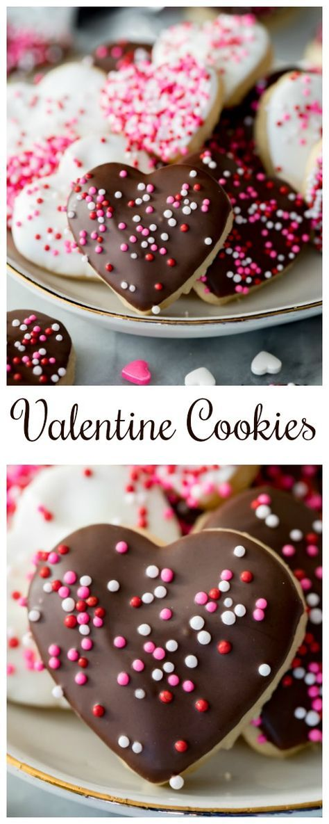 Valentine Cookies are made with a simple sugar cookie bases and are dipped in white and dark chocolate and decorated with sprinkles! These are the perfect Valentine's Day dessert! #valentinesday #valentine #cookies #recipe #dessert #valentinesdayrecipe #valentinesdaydessert #sugarcookie #heartcookie via @sugarspunrun